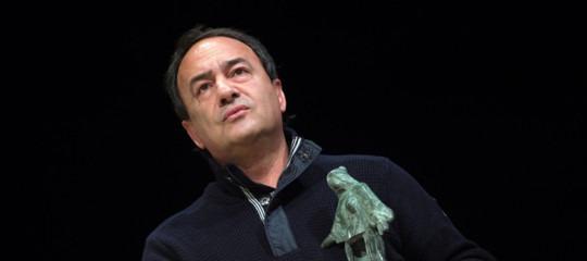 Riace manifestazione sindaco Lucano migranti corteo